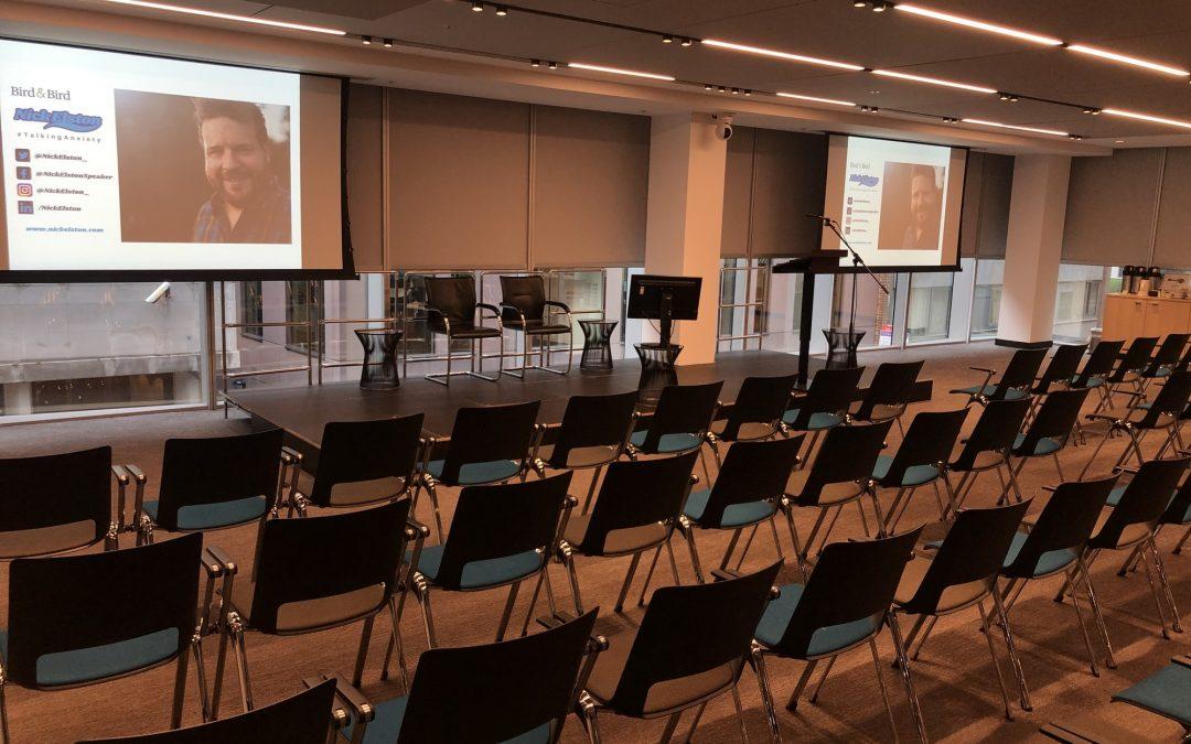 Nick Elston. Inspirational Speaker setup to speak in conference hall.