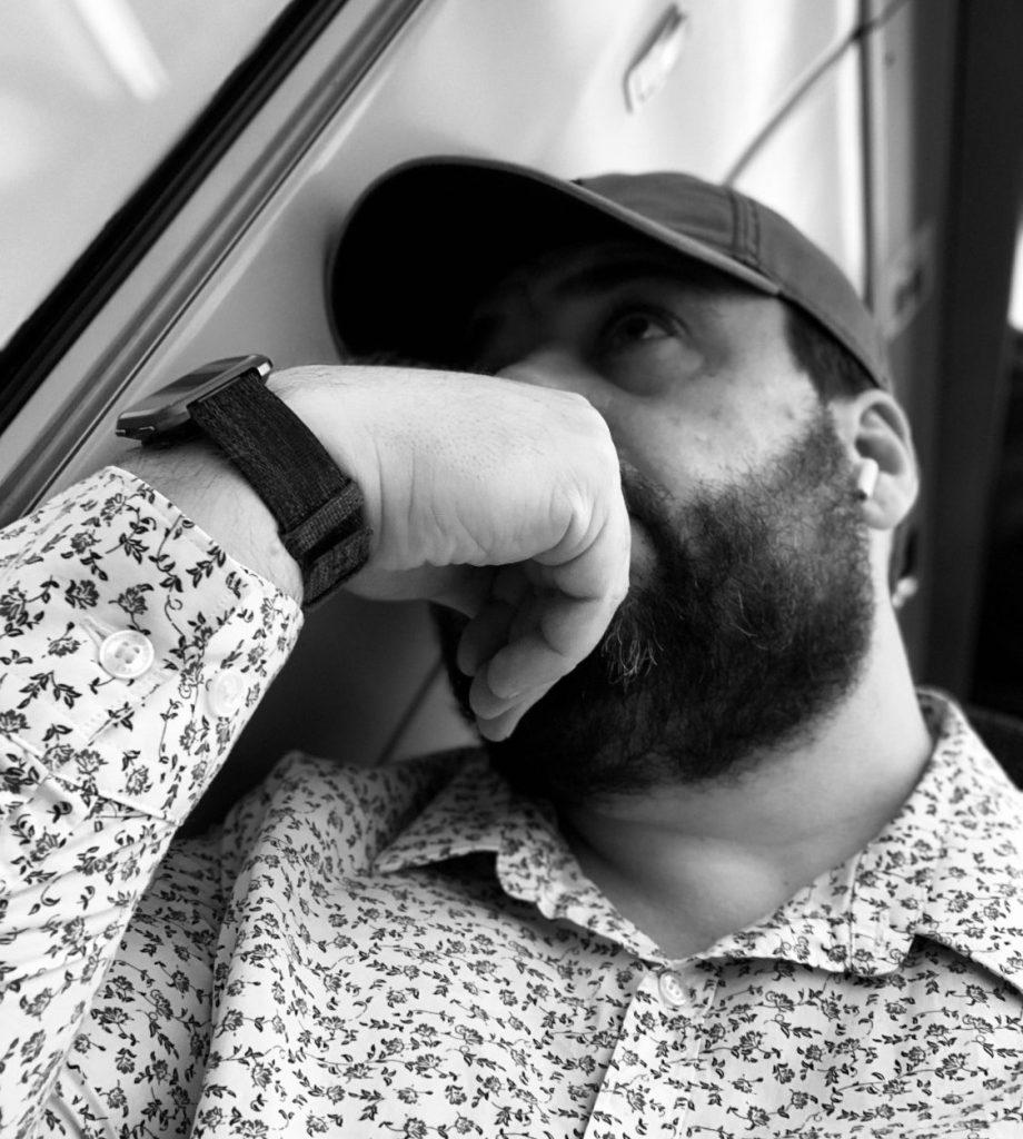 Nick Elston reflection on a train